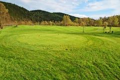 Roter abzweigender Boden auf dem Golfplatz Lizenzfreie Stockfotografie