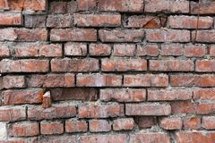 Roter alter getragener Backsteinmauerbeschaffenheitshintergrund Weinlese-Effekt stockfotografie