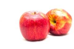 Roter Apfel auf dem weißen Hintergrund herausgeschnitten Lizenzfreies Stockfoto
