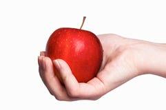 Roter Apfel in der Frauenhand trennte Lizenzfreies Stockbild