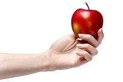 Roter Apfel in der schönen Hand lokalisiert auf Weiß Stockbilder