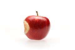Roter Apfel mit Bissen Stockfotos