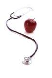 Roter Apple und ein Stethescope Stockfoto