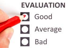 Roter Bleistift auf einem evaluationform Lizenzfreies Stockfoto