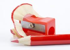 roter BleistiftBleistiftspitzer Lizenzfreie Stockbilder