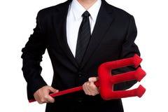 Roter Dreizack des Geschäftsmann-Griffs lokalisiert Lizenzfreie Stockfotos