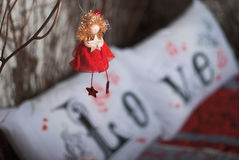 Roter Engel mit Stern Stockfotografie