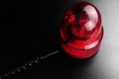 Roter Fahrzeug-Polizei-Röhrenblitz-drehendes warnendes Notleuchtfeuer Fla Lizenzfreies Stockfoto