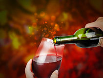 Roter Feier-Wein mit Scheinen Stockfotografie