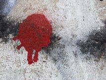 Roter Fleck auf der Wand stockfotos