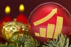 Roter Flitter mit der goldenen Form eines wachsenden Balkendiagramms serie Lizenzfreies Stockbild