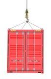 Roter Frachtbehälter hochgezogen durch Haken Stockfoto