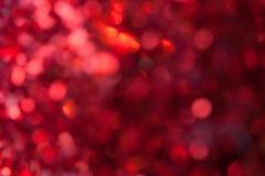 Roter funkelnder Hintergrund von den kleinen Pailletten, Nahaufnahme Glänzender Hintergrund Lizenzfreie Stockfotos
