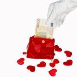 Roter Geldbeutel mit Eurobanknote fünfzig und Herzen Lizenzfreies Stockbild