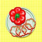 Roter Gemüsepaprika auf einer Platte mit Scheiben Stockbild