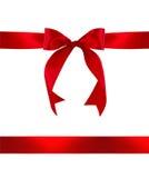 Roter Geschenk-Bogen und Farbband lizenzfreie stockfotografie