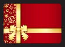 Roter Gutschein mit goldenen Schneeflocken und Band Stockfoto