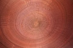 Roter hölzerner Weidenkreisbeschaffenheitshintergrund stockbilder