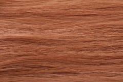 Roter Haarhintergrund Stockfotos