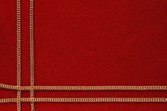 Roter Hintergrund mit goldener Kette Lizenzfreies Stockfoto