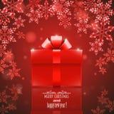 Roter Hintergrund mit Schneeflocken und Geschenk Stockfotos