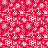 Roter Hintergrund mit weißen Schneeflocken stockbild
