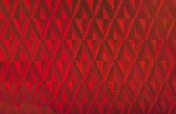 Roter Hologrammhintergrund. Stockfoto