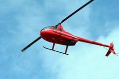 Roter Hubschrauber Stockbild