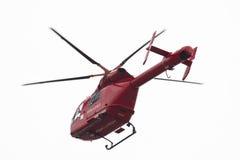 Roter Hubschrauber getrennt auf Weiß Stockfoto