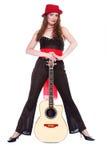 Roter Hut und Gitarre Lizenzfreie Stockfotografie