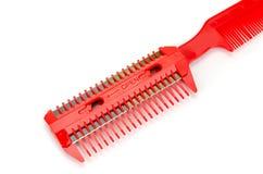Roter Kamm mit Rasiermesser Stockbilder