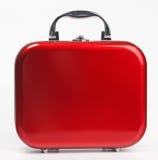 Roter kleiner Koffer Lizenzfreie Stockbilder