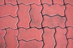 Roter Kopfsteinhintergrund, Stein, der Beschaffenheit pflastert Lizenzfreies Stockfoto