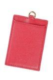 roter lederner Aufkleber mit dem Kreditkarteloch lokalisiert auf Weiß Lizenzfreie Stockfotos