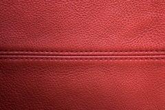 Roter lederner Hintergrund Stockfotos