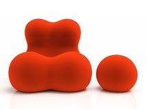 Roter Lehnsessel und aufgefüllter Schemel Stockbild