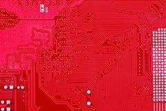 Roter Leiterplatte-Beschaffenheitshintergrund des Computermotherboards Lizenzfreie Stockbilder