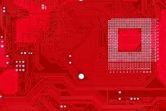 Roter Leiterplatte-Beschaffenheitshintergrund des Computermotherboards Lizenzfreie Stockfotos