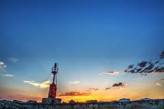 Roter Leuchtturm in Alghero-Hafen Lizenzfreie Stockbilder