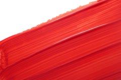 Roter Lippenstiftfleck Stockfoto