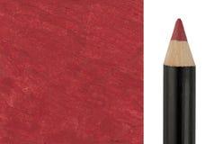 Roter Make-upbleistift mit Beispielanschlag Stockbilder