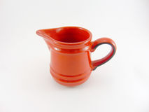 Roter Milchkrug Stockfotografie