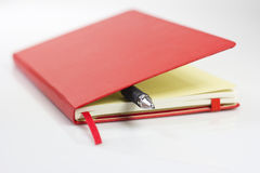 Roter Moleskinkalender Stockbilder