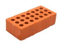 Roter perforierter keramischer Ziegelstein getrennt auf Weiß Lizenzfreies Stockfoto