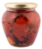 Roter Pfeffer in einem Glas lokalisiert Stockbild
