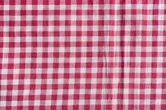 Roter Picknicktischdeckenhintergrund Stockfotografie