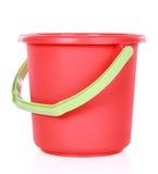 Roter Plastikeimer lizenzfreie stockfotografie
