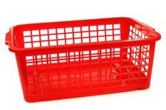 Roter Plastikkorb Stockfoto