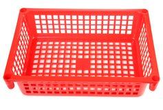 Roter Plastikkorb Stockbild
