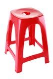 Roter Plastikstuhl Stockbild